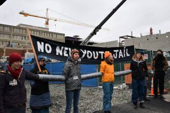 Protesters from the No New Youth Jail Coalition block entry points to the construction site, stopping supplies from entering. Liberation photo Lee Hessler.