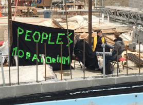 Protesters from communities of faith are locked down on construction site